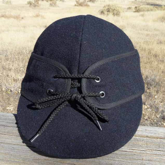 TIPS Railroad caps are made in Canada of 100% Wool shell. They are insulated with a polyester fill and a quilted nylon liner. Drop down inside ear flaps and outside flaps as well. Offered in sizes 6 3/4 to 7 3/4 in Black, Brown, Navy, and Grey.